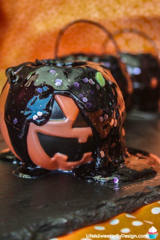 glitter black slime in jack-o-lantern