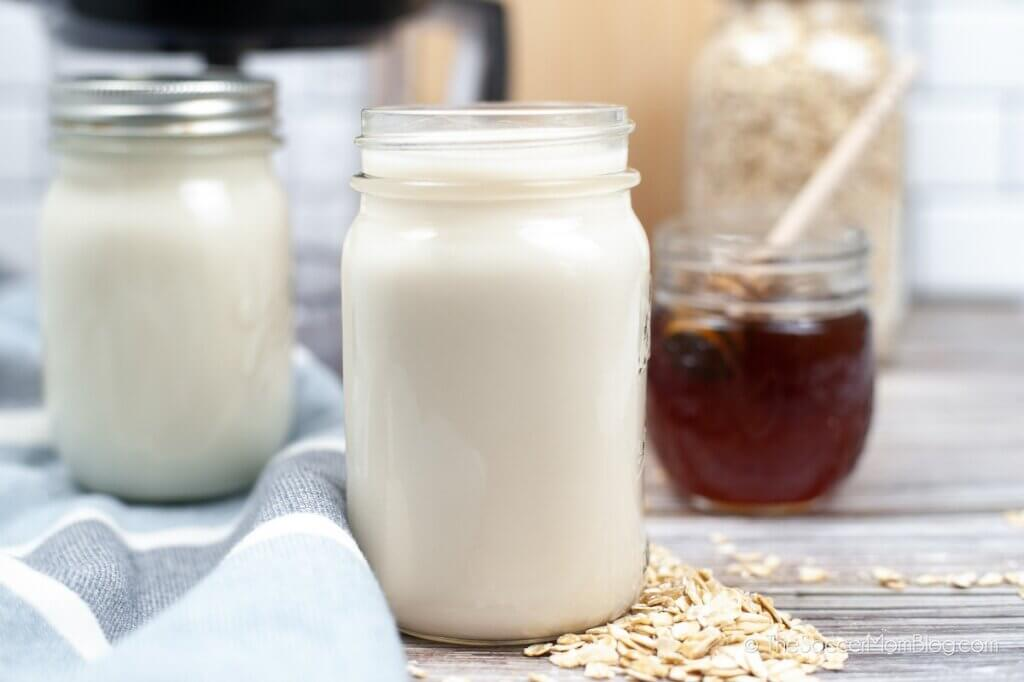 Jars filled with oat milk and honey
