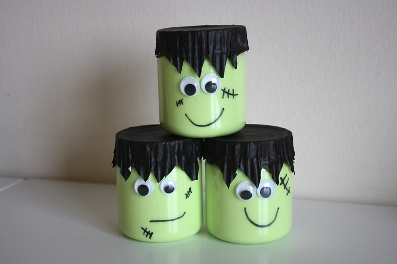 jars of Halloween slime decorated like Frankenstein