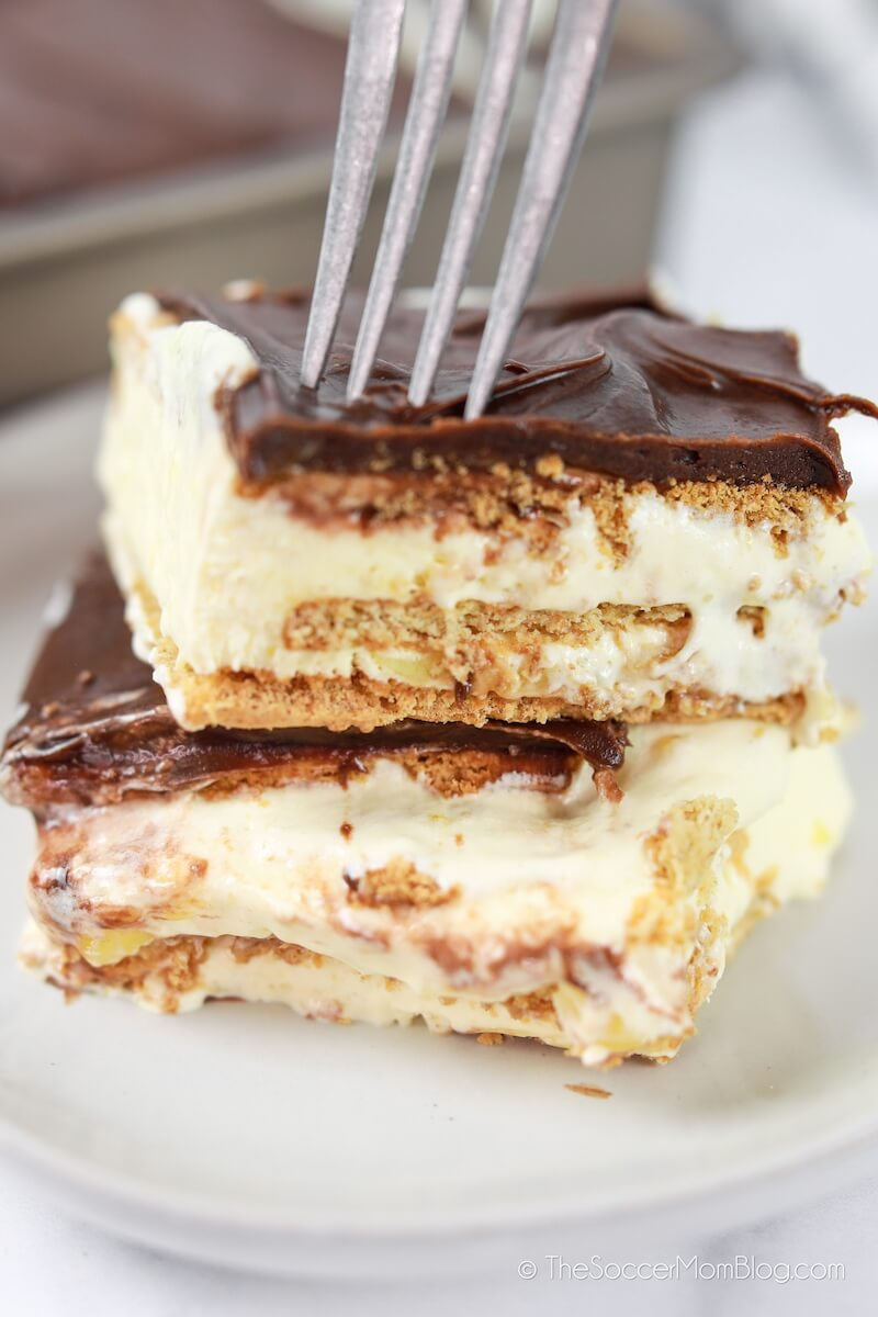cutting into a piece of eclair cake