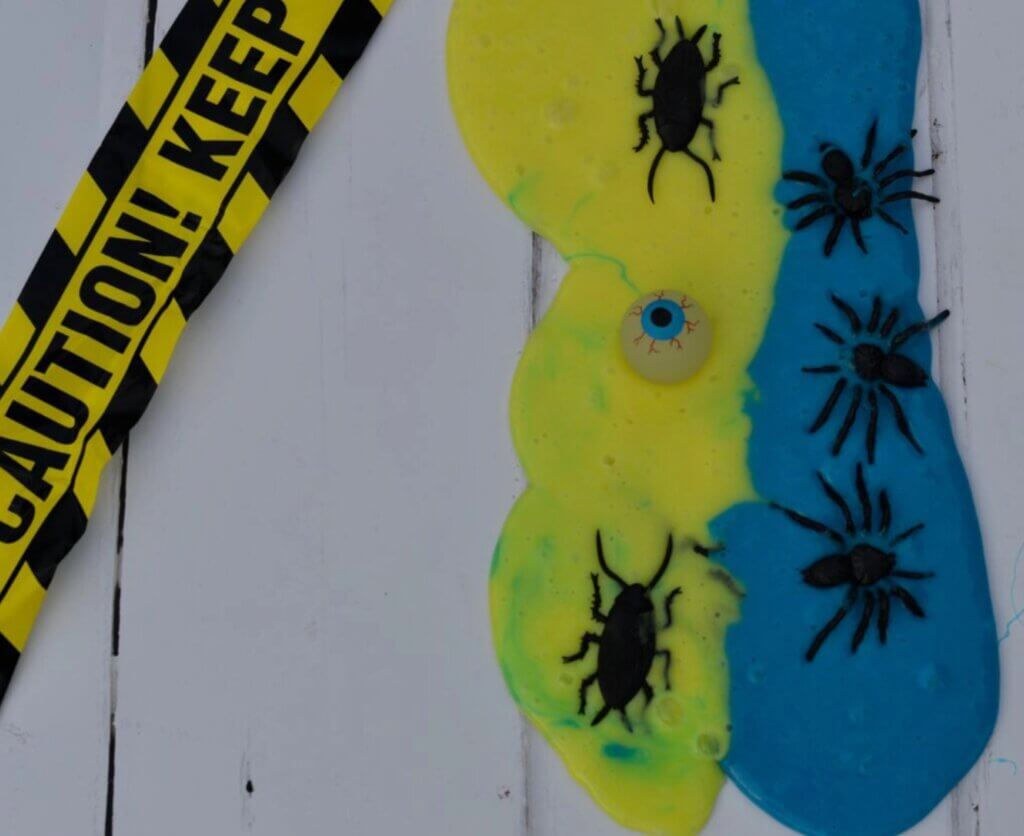 blue and yellow slime with fake bugs