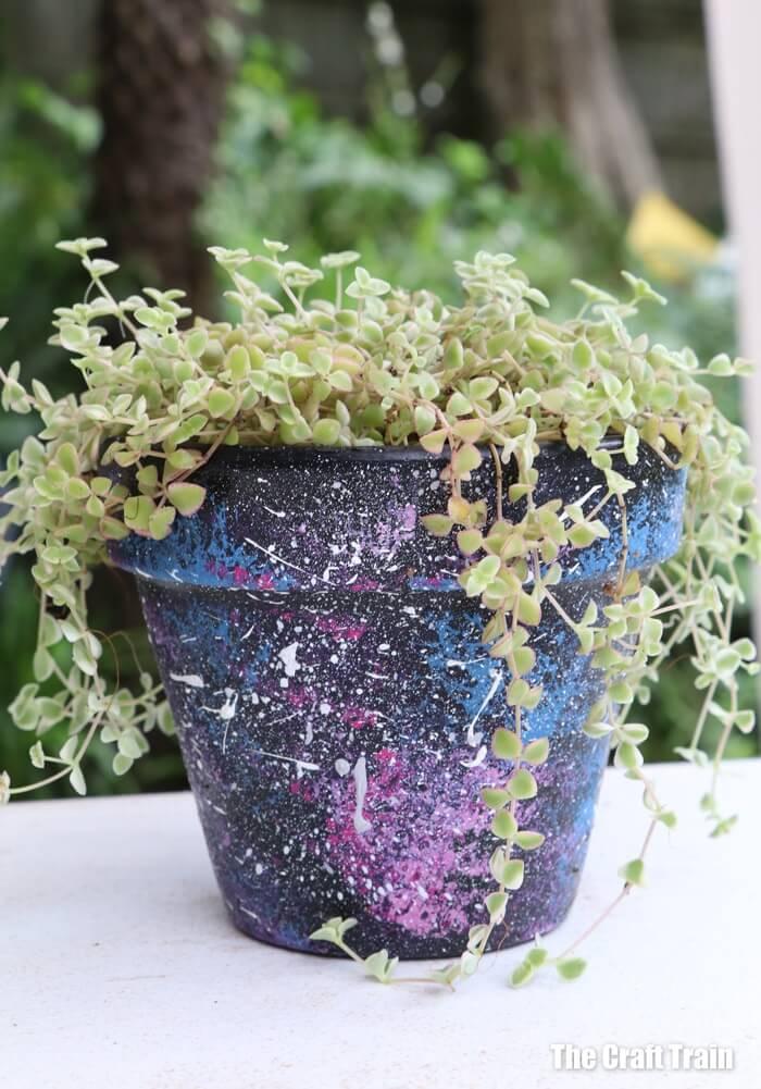 flower pot painted with galaxy splatter art