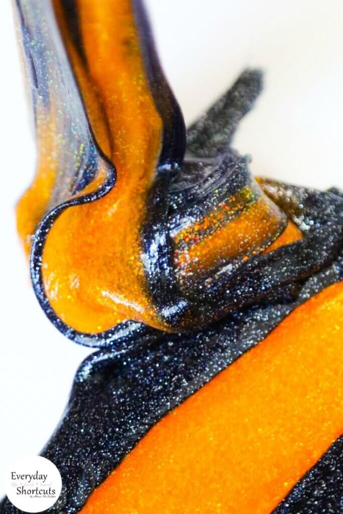 orange and black glitter slime