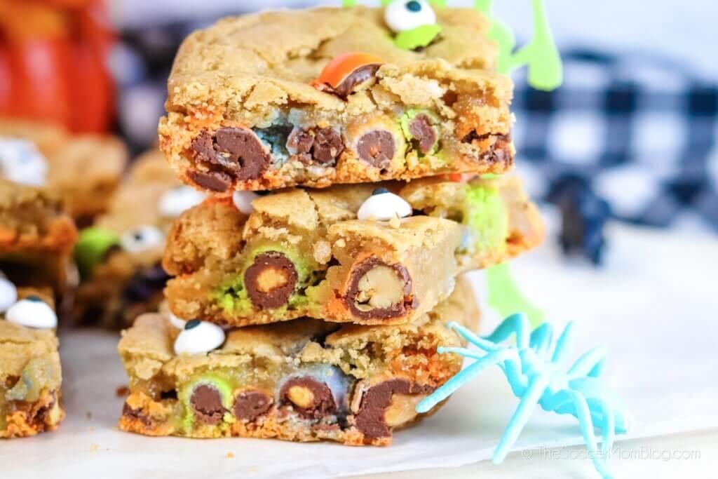 Three Halloween cookie bars with candy eyeballs