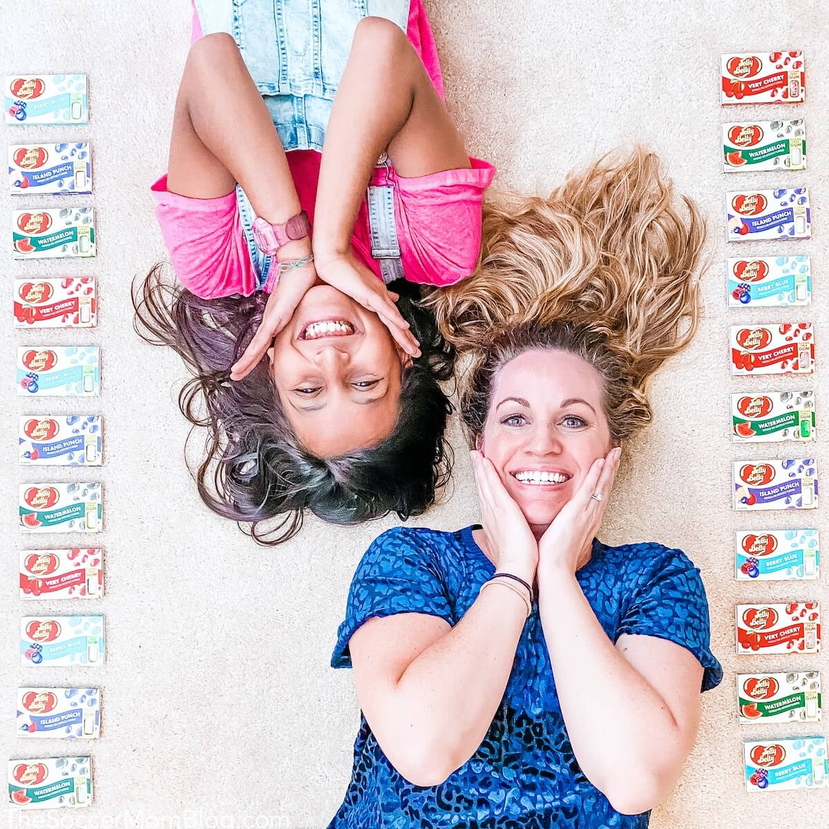 little girl and mom lying on floor with gum around them