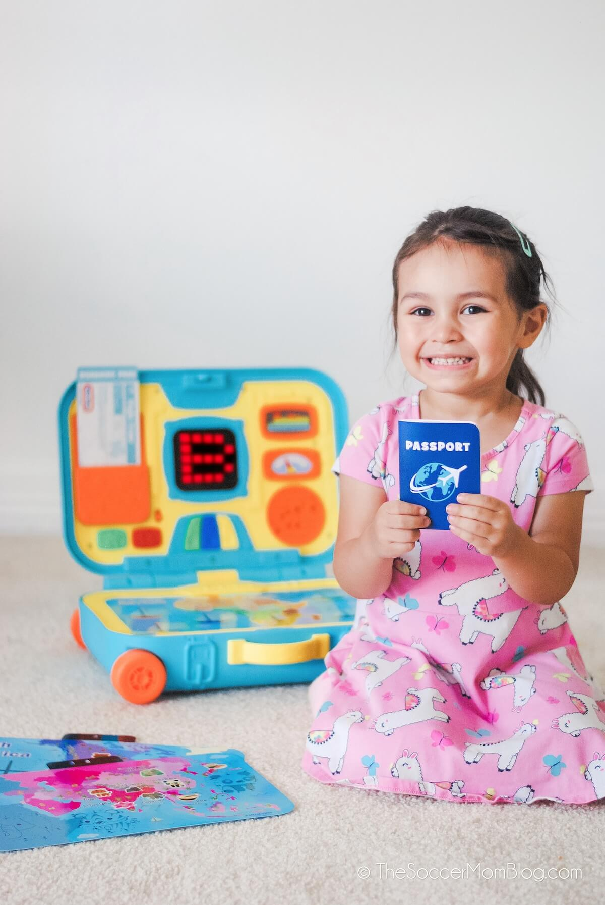 little girl holding toy passport