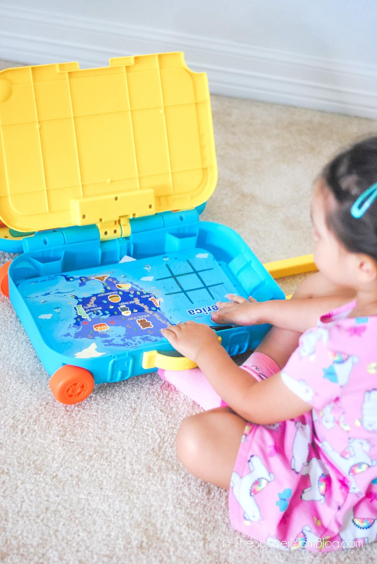 putting activities in a toy suitcase