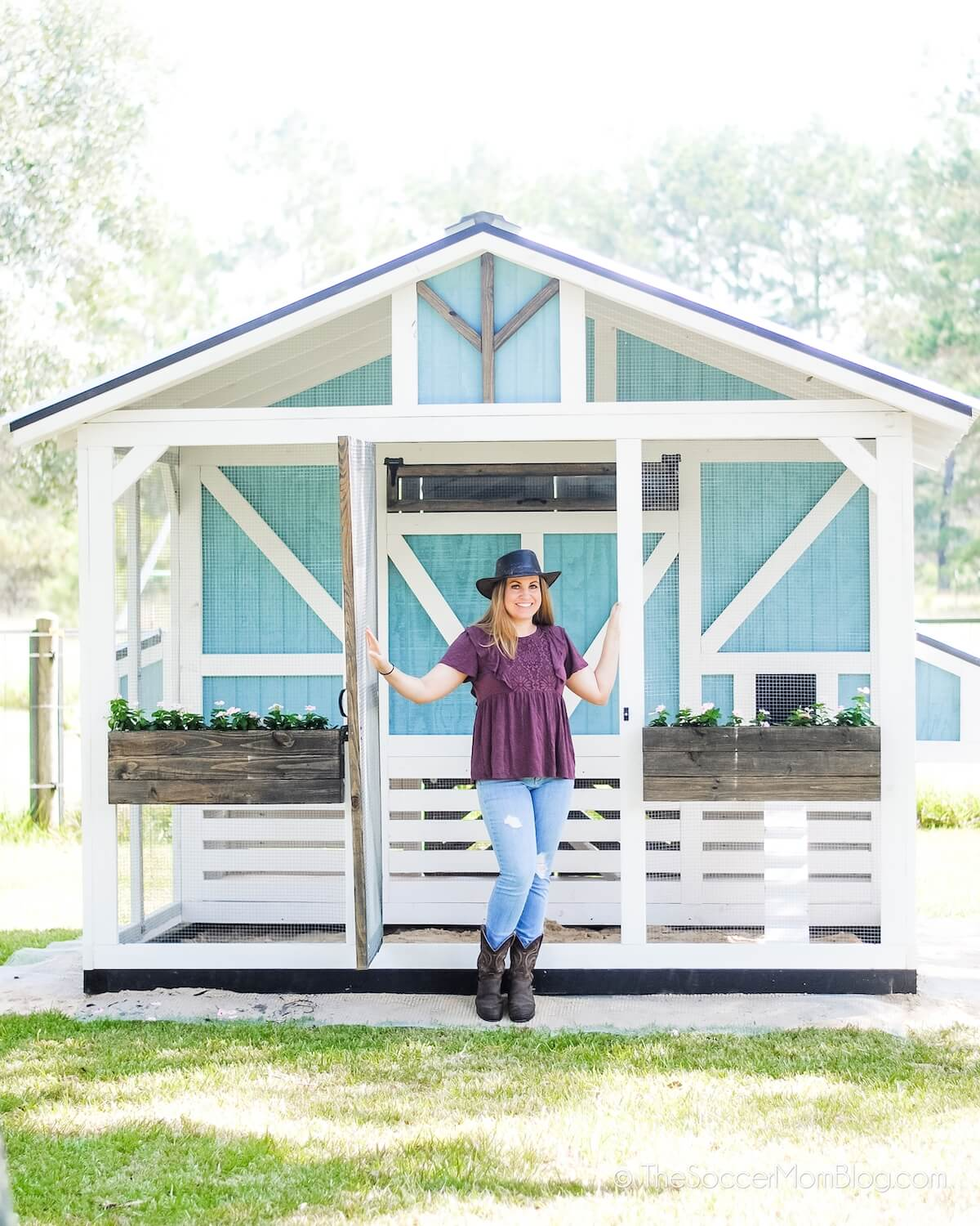 woman with cottage style chicken coop