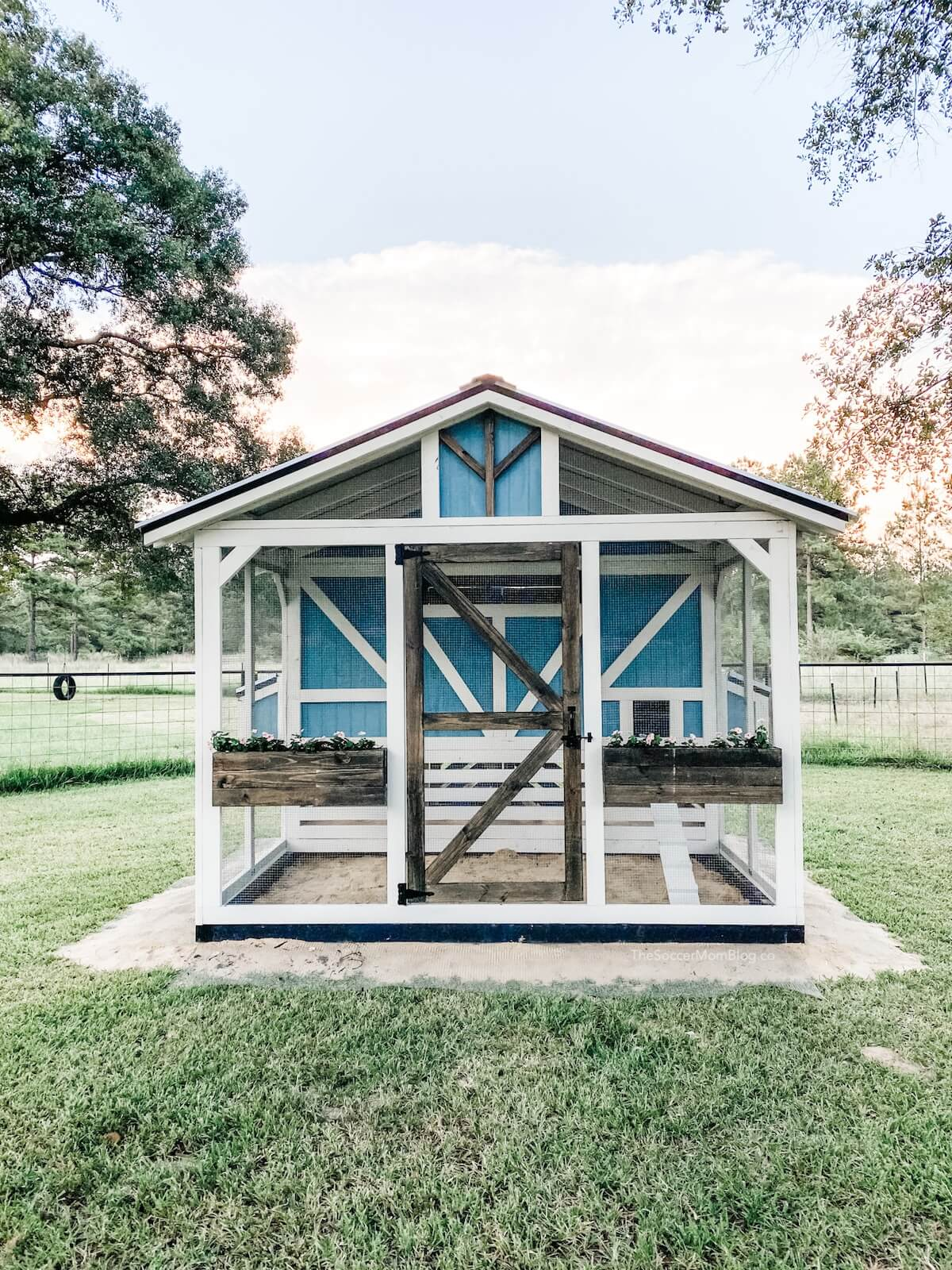 farmhouse wooden chicken coop at sunset
