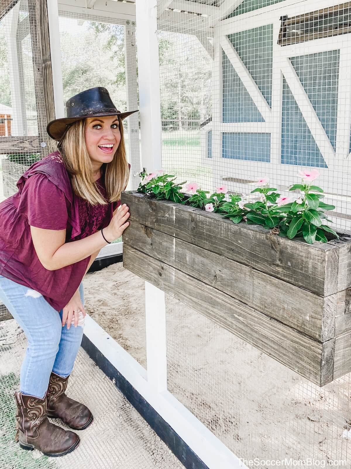 woman posing with wooden flower planter