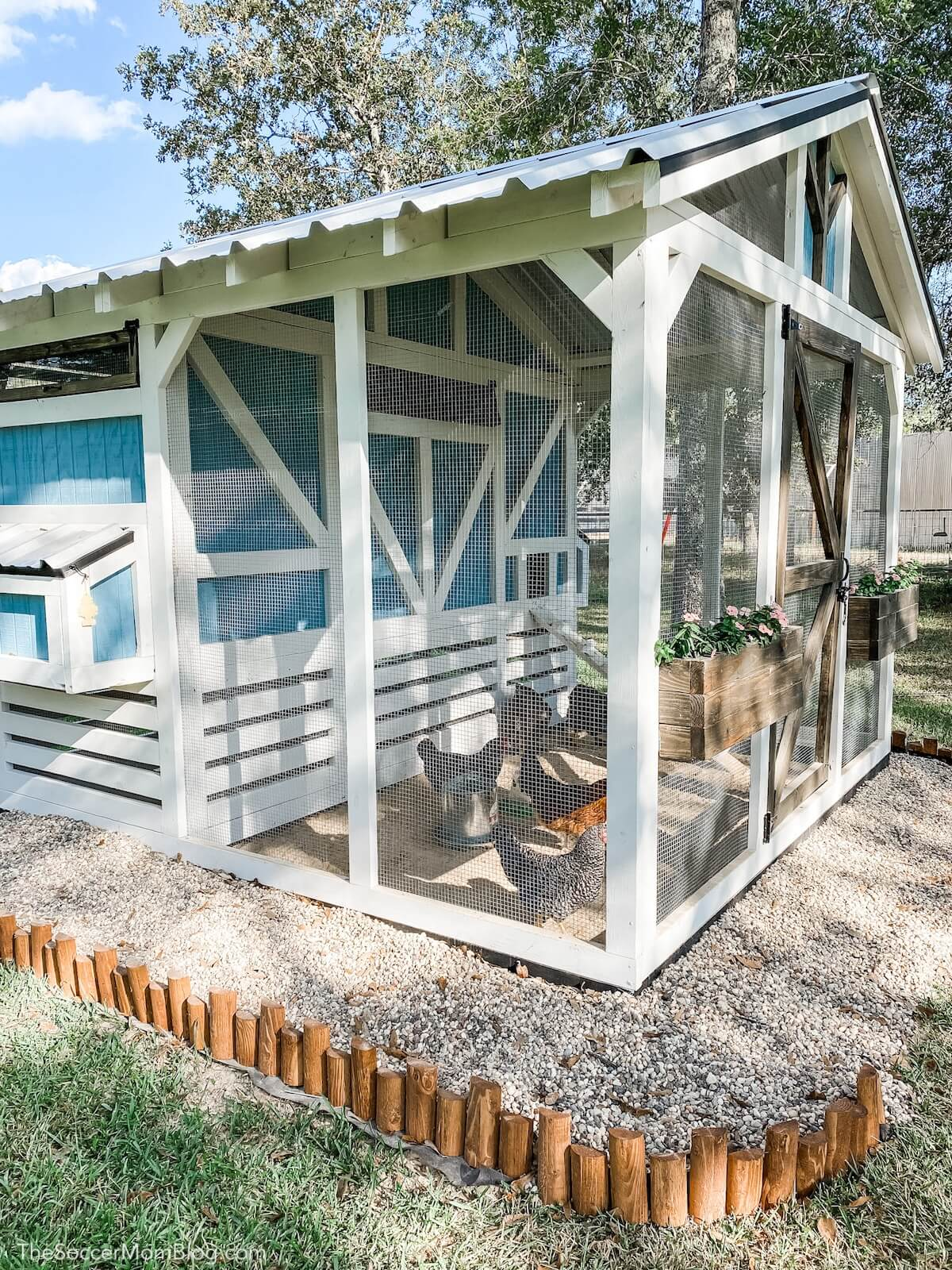 side view of wooden cottage style chicken coop and run