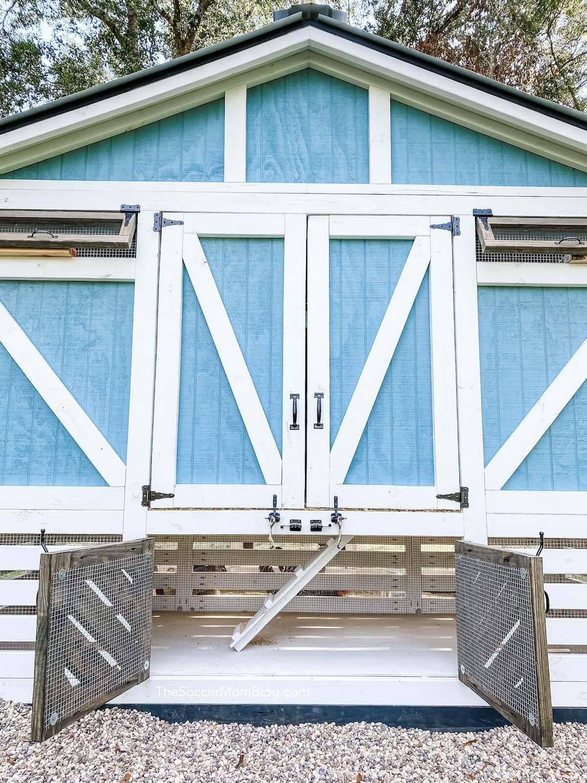 back of wooden chicken coop, bottom doors open