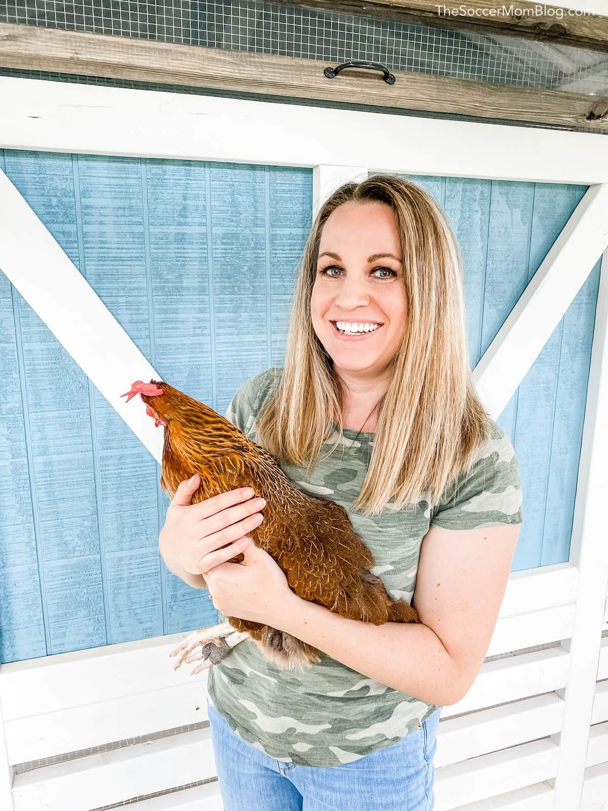 woman holding chicken