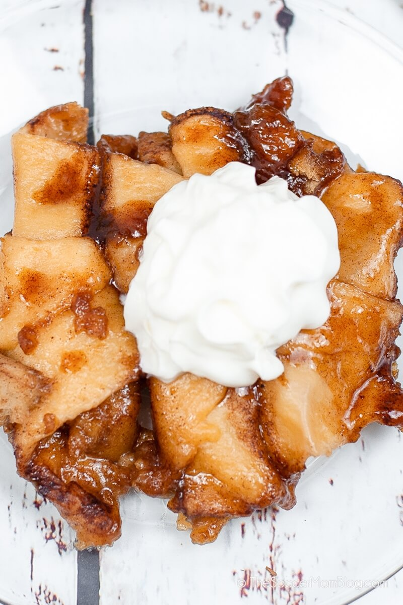 gooey cinnamon apple dumplings with whipped cream